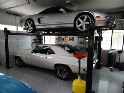 Crowded Garage Look At A Car Lift For Your Collection