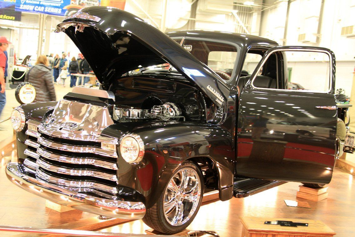 Chevy 3100 black pickup turns heads